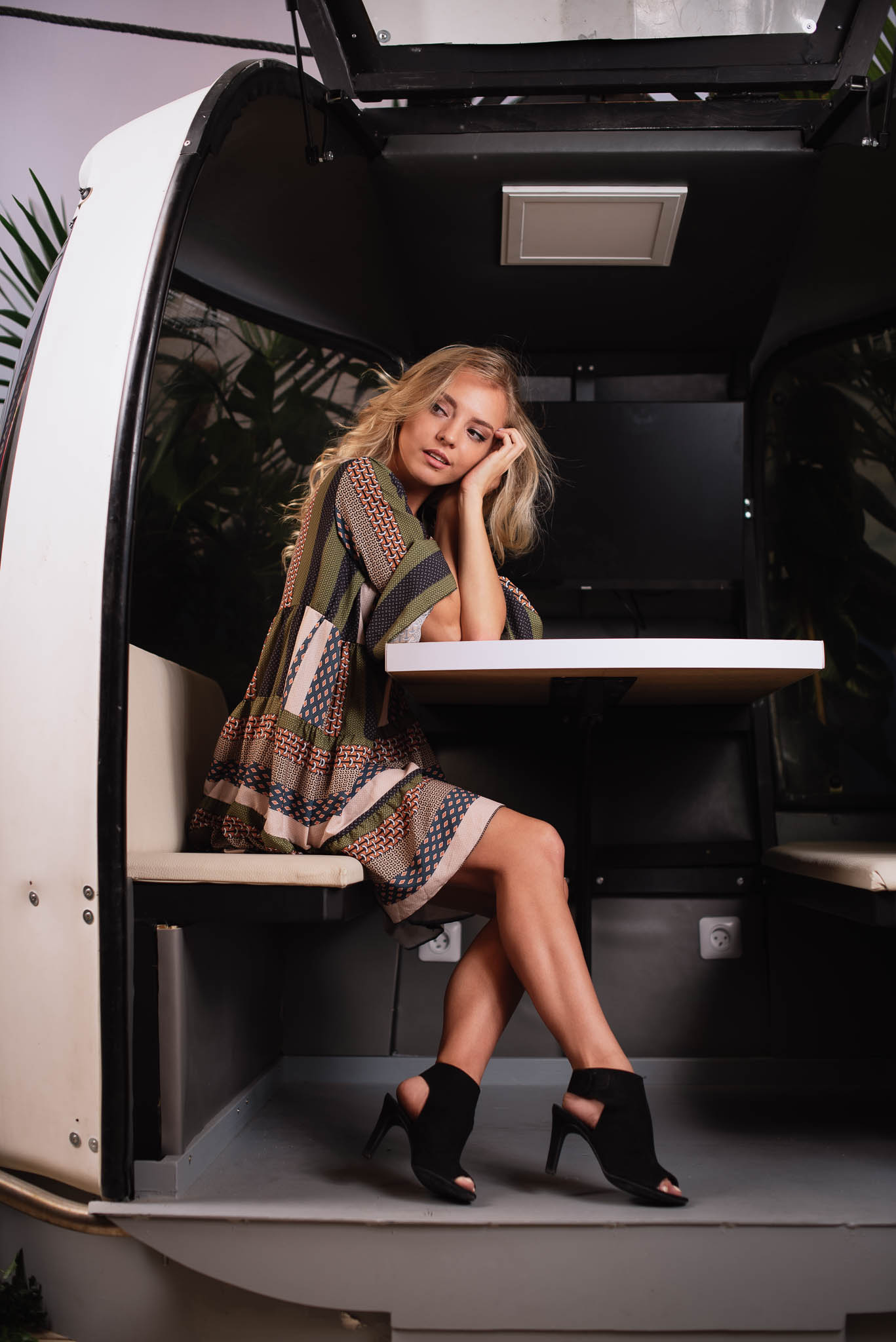 fashion photography in swiss gondola studio lighting blonde in dress and heels