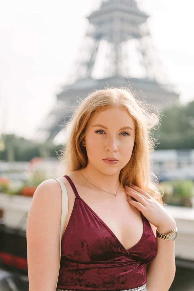 portrait photoshoot in front of the eiffel tower in paris with solo traveler