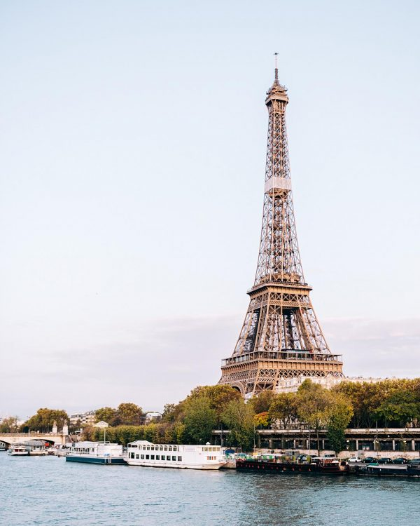 Print for Sale on Paige Gribb Photography - The Eiffel Tower as seen from the Bir-Hakeim bridge just before sunset with slightly pink clouds